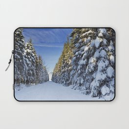 Trail through beautiful winter forest on a clear day Laptop Sleeve