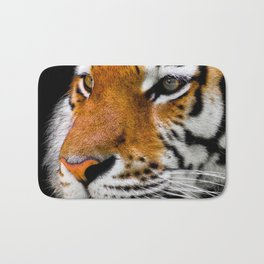 Cute close-up picture of tiger on black background Bath Mat