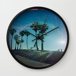 The solo surfer Wall Clock