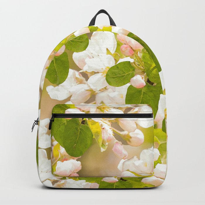 Apple tree branches with lovely flowers and buds on a pastel green background Backpack