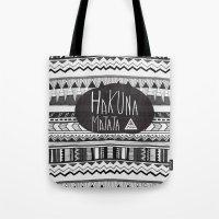 hakuna Tote Bags featuring HAKUNA MATATA  by Vasare Nar