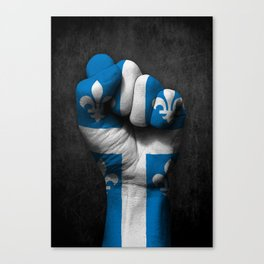Quebec Flag on a Raised Clenched Fist Canvas Print