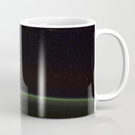Comet Lovejoy is visible near Earths horizon in this nighttime image photographed by NASA Coffee Mug