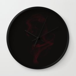 Red smoke on black backgound Wall Clock