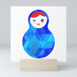 wink Russian doll matryoshka with bright rhombus on white background, blue colors Mini Art Print