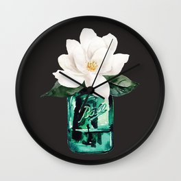 Magnolia in a glass jar with black background Wall Clock