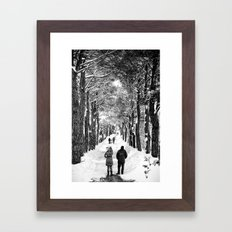 Couple on snowy street Framed Art Print