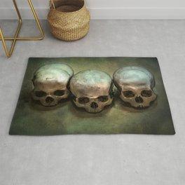Three human skulls Rug