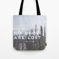 not all who wander Tote Bags featuring Not all who wander... by E. Phillips - Creative Designer
