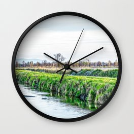 Irrigation ditch in the Ticino river natural park during winter before sunset Wall Clock