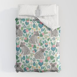 Cute gray koalas with ornaments, tropical flowers and leaves. Seamless tropical pattern. Comforters