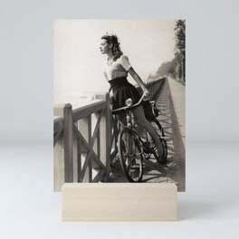Girl on a Bicycle near palms black and white photograph / art photography Mini Art Print