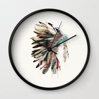 headdress Wall Clocks featuring native headdress by bri.buckley