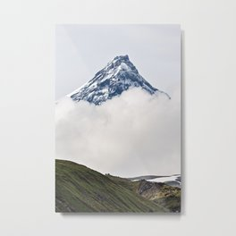 Beautiful mountain landscape, view on snowy top of rocky volcano cone in clouds Metal Print