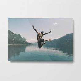 A man jumping with joy by a like Metal Print