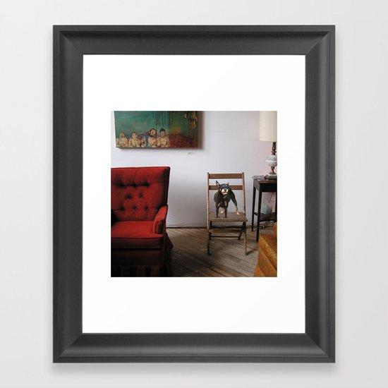 red chair Framed Art Print
