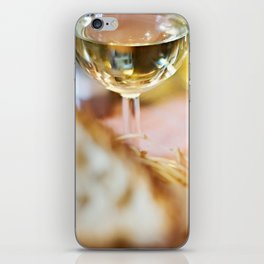 Glasses of white wine and salad on cafe iPhone Skin