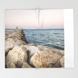 Sunset at the seawall Throw Blanket