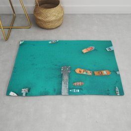 boats in the pier Rug