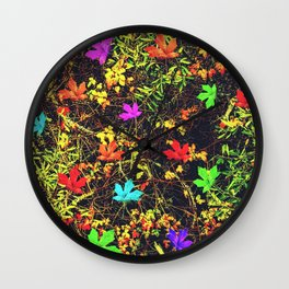 maple leaf in blue red green yellow pink orange with green creepers plants background Wall Clock