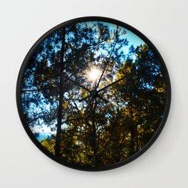Sun Peeking Through Trees Wall Clock