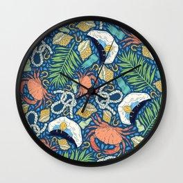 Cap and crab with seashells on water drops Wall Clock
