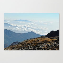 walking above the clouds Canvas Print