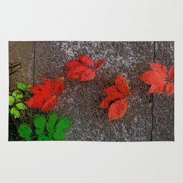Red and green leaves on the wall Rug