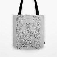 terminator Tote Bags featuring terminator polynesian by Andrew Mark Hunter