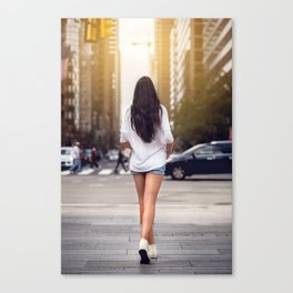 Beautiful girl with long legs walking around New York City street wearing jeans shorts. Rear view. Canvas Print