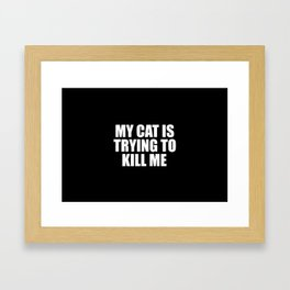 my cat is trying to kill me funny saying Framed Art Print
