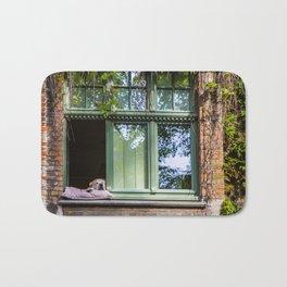 A dog at the window (Bruges' Most Famous Citizen) Bath Mat