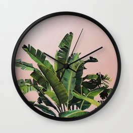 Tropical Palm leaves on pink Wall Clock