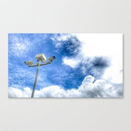 Bottom view shot of surveillance pole on sunny day. Canvas Print