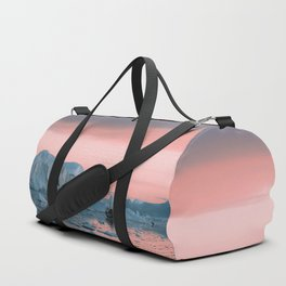 Boat in front of arctic icebergs during sunset Duffle Bag