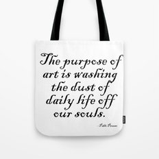 The purpose of art is washing the dust of daily life off our souls. – Pablo Picasso Tote Bag