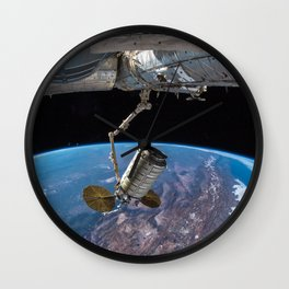 65. SS John Young Cargo Craft Docks to Space Station Wall Clock