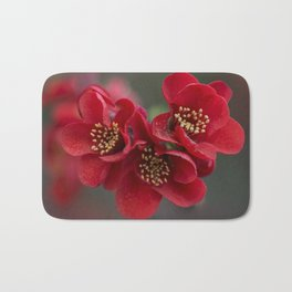 Red Chaenomeles flowers Bath Mat
