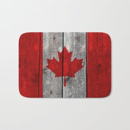 Canada flag on heavily textured woodgrain  Bath Mat