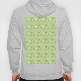 Colorful bunnies on green background Hoody