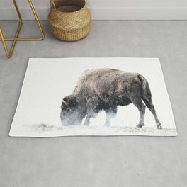 Bison grazing in a snowstorm Rug