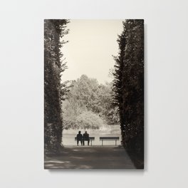 Two old people sitting on bench between hedge Metal Print
