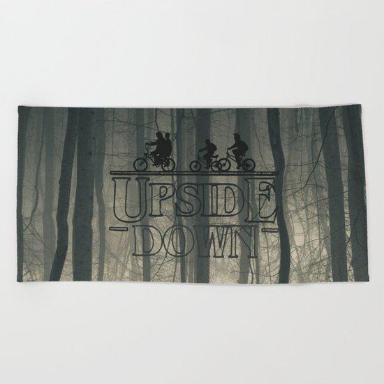 Upside down world Beach Towel