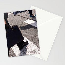 Group of businessmen and women walk along crosswalk in Shinjuku, Tokyo, Japan Stationery Cards