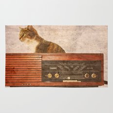 The Cat and the Radio Rug