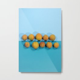 Ripe apricots on a blue background Metal Print