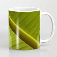 banana leaf Mugs featuring Banana Leaf by Maria Heyens