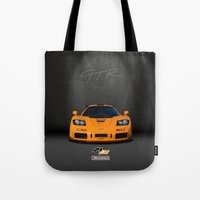 f1 Tote Bags featuring 1995 McLaren F1 LM  by vsixdesign