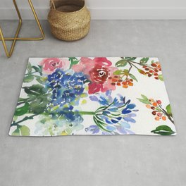 roses and hydrangeas in the garden Rug