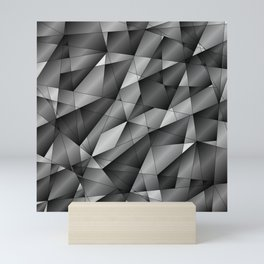 Exclusive monochrome pattern of chaotic black and white fragments of glass, metal and ice floes. Mini Art Print